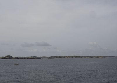 Augustmorgen med Landøy og i horisonten.